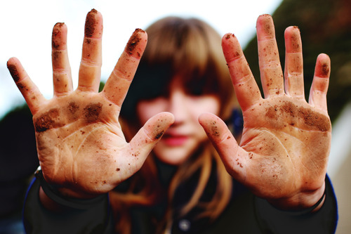 Image of woman with dirty hands