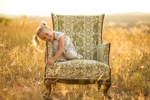 Little Girl in Chair in Field
