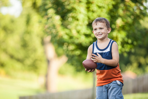 Young Boy Catching Football