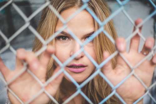 fenced_in_woman